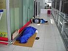 Workers taking a nap at Suvarnabhumi Airport.JPG