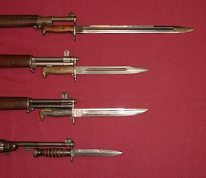 M1905 bayonet - U.S. military bayonets of World War II. Shown are the M1905 Bayonet (blued version), M1 Bayonet, M1905E1 Bowie Point Bayonet (cut down version of the M1905) and the M4 Bayonet with leather handle for the M1 Carbine (bottom).