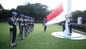 "Flag of Indonesia - Paspampres personnel from the ""State Protocol Escort Battalion (Yonwalprotneg)"" raising the Flag of Indonesia in the national palace yard"