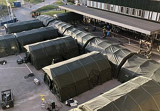 An army-constructed field hospital outside Ostra sjukhuset (Eastern hospital) in Gothenburg, Sweden, contains temporary intensive care units for COVID-19 patients. Ostra Sjukhuset COVID-19 Faltsjukhus.jpg