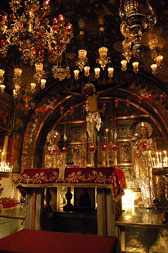 Church of the Holy Sepulchre - The Altar of the Crucifixion, where the Rock of Calvary can be seen behind protective glass