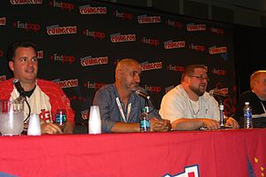 Axel Alonso - Alonso (center) during the Marvel NOW! panel at the 2012 New York Comic-Con. Seated with him from left to right are editor Steve Wacker, C.B. Cebulski and (barely visible) Jeph Loeb.