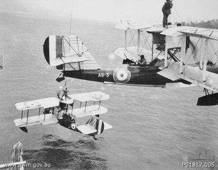 Two Supermarine Seagull III seaplanes of No. 101 Flight being hoisted onto HMAS Albatross