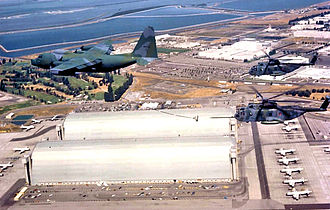 129th Rescue Squadron - An HC-130P refueling a HH-3Es over Moffett Federal Airfield, 1990.