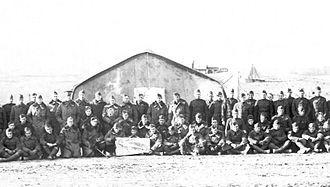139th Aero Squadron - Squadron members with unit emblem, Souilly Aerodrome, France, November 1918