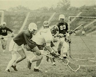 Johns Hopkins–Maryland rivalry - Maryland and Hopkins players scramble for the ball during the 1955 game.