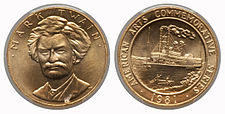 A gold medallion depicting a man and a steamship