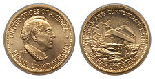 A gold medallion depicting a man and building