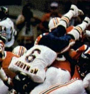 Super Bowl XX - Jim McMahon dives into the end zone to score a touchdown.