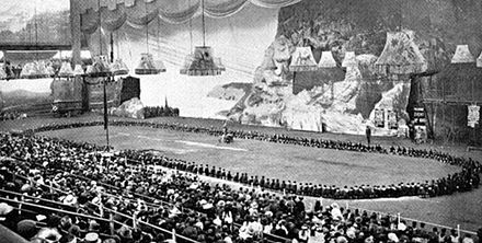 At the First World Jamboree in August 1920, 500 Wolf Cubs perform a Grand Howl in the arena at Olympia, London 1st World Jamboree Cubs Grand Howl.jpg