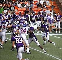 78387d40bae1 Johnson rushing the ball on a play during the 2007 Hawaii Bowl.