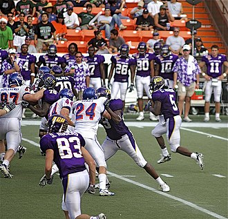 Chris Johnson (running back) - Johnson rushing the ball on a play during the 2007 Hawaii Bowl.