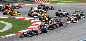 The opening corner of the 2010 Malaysian Grand Prix being led by eventual world champion Sebastian Vettel