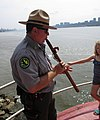 2015 Little Red Lighthouse annual tour (10) Park Ranger playing recorder on gallery deck.jpg