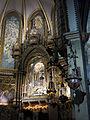 205 Basílica de Montserrat, templet del presbiteri i llànties votives.JPG