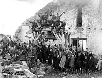 80th Division (United States) - Members of the 80th Division, 305th Field Signal Battalion, with children of the village of Vaubecourt, Meuse, France (October 21, 1918)