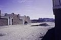 ASC Leiden - van Achterberg Collection - 14 - 03 - Une personne avec un âne chargé dans le quartier de Sersouf - Tamanrasset, Algérie - 1984.jpg