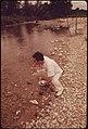 A Local Health Officer Taking a Water Sample from the Frio River near Leakey, Texas, near San Antonio, 05-1973 (3703573029).jpg