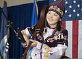A Mukash Abdraev National School of Music student, dressed in a traditional Kyrgyz outfit, plays the komuz during a concert, April 4, 2013, at the Transit Center at Manas, Kyrgyzstan 130404-F-KZ210-112.jpg