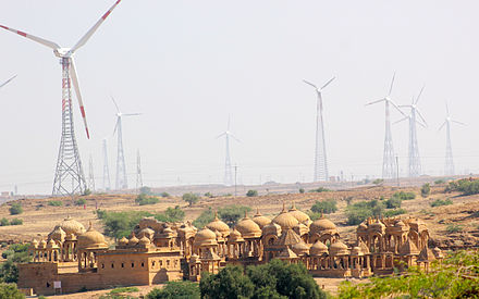 A wind farm overlooking Bada Bagh, India A Wind Energy farm and the Cenotaphs, the ancient and the modern, Jaisalmer Rajasthan India.jpg