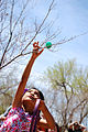 A child collects an egg at an Easter egg hunt March 30, 2013, at Unity Park at Cannon Air Force Base, N.M. More than 400 children participated in the hunt, gathering more than 3,000 hidden eggs 130330-F-KB862-062.jpg