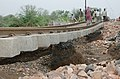 A still of railway track repair work is on progress in the flood-affected areas at Shedhi River, 36 kilometers away from Ahmedabad, Gujarat on July 7, 2005.jpg