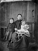 A woman and two children NLW3364714.jpg