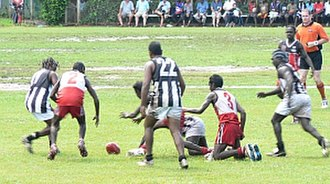 Australian rules football in Australia - Contesting for possession in an indigenous community football game in the Northern Territory