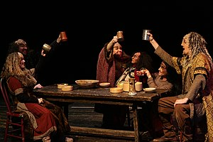 Actors in klingon costumes raise cups on table.jpg