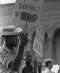 African American and white supporters of the Mississippi Freedom Democratic Party holding signs in front of the convention hall at the 1964 Democratic National Convention, Atlantic City, New Jersey (cropped1).jpg