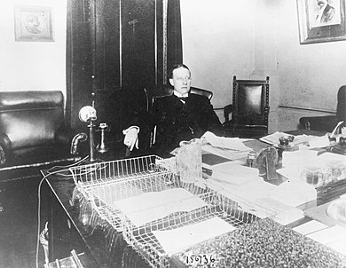 Smith at his desk in the New York Assembly in 1913 AlSmithDesk1913.jpg