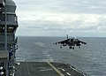 An AV-8B Harrier lands aboard the amphibious assault ship USS America (LHA 6). (16441349629).jpg