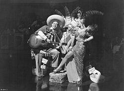 Promotional picture with Andy Russell as a Latin musician and Miranda in her usual costume