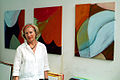 Angelika Wolf vor einigen ihrer Arbeiten, hier im Atelier Block 16, Hannover Nordstadt, beim Zinnober-Volkskunstlauf 2012.jpg