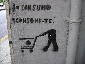 "Anti-consumerism - An anti-consumerist stencil graffiti saying ""Consuming consumes you"""