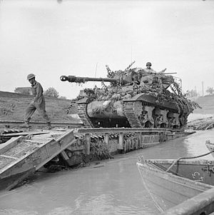 17pdr SP Achilles - An Achilles 17pdr Self-Propelled Anti-Tank Gun crossing the River Savio on a Churchill ARK which was driven into the river, 24 October 1944