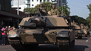 Armoured vehicles parading through Darwin on 25 April 2015