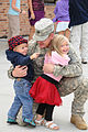 Army Capt. Brad Loween of the 1st Battalion, 112th Aviation Regiment (Security and Support), hugs his children, after returning from a year long deployment, in Fargo, N.D., Sept 120913-Z-WA217-042.jpg