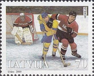 Sandis Ozoliņš - Ozoliņš (right) on a 2000 Latvian stamp