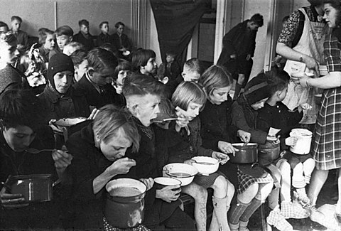 Dutch children eating soup during the famine of 1944-45 BC856 HUI-2050.jpg