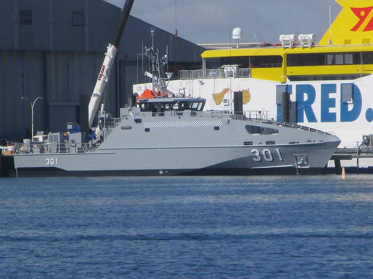 https://upload.wikimedia.org/wikipedia/commons/thumb/1/14/Bajamar_Express_and_RKS_Teanoai_II_%28301%29_at_Austal_shipyards_in_Henderson%2C_Western_Australia%2C_April_2020_01.jpg/1280px-Bajamar_Express_and_RKS_Teanoai_II_%28301%29_at_Austal_shipyards_in_Henderson%2C_Western_Australia%2C_April_2020_01.jpg