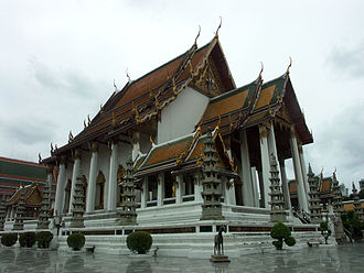 Wat - The facade to the Phra wihan Luang (meeting hall) at Wat Suthat, one of the Buddhist temples in Bangkok, Thailand