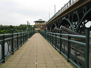 Tees Barrage - View along the footbridge/cycleway with north bank pavilion in the background