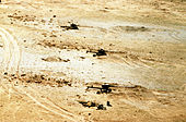 Battery of damaged Iraqi artillery in southern Iraq 1991-03-27.JPEG