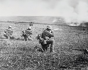45th Battalion (Australia) - Members of the 45th Battalion in action at the Battle of the Hindenburg Line, during September 1918. (The man kneeling on the far left is believed to be Private Edward Lynch)