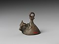 Bell with head of a bovine wearing a yoke ending in uraei MET DP239486.jpg