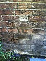 Benchmark on wall of Wollaston Road - geograph.org.uk - 2083994.jpg