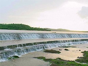 Bindusara River - Bendsura dam overflowing in monsoon. Balaghat Range can be seen in the background.