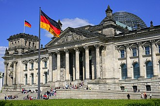 Bundestag - The German Unity Flag is a national memorial to German Reunification that was raised on 3 October 1990; it waves in front of the Reichstag building in Berlin, seat of the Bundestag