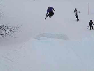 "Mulligan's Hollow Ski Bowl - Local skier catching ""Big Air"" on one of the many jumps at Mulligan's Hollow."